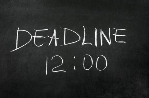 blackboard with the word 'deadline 12:00' written on it
